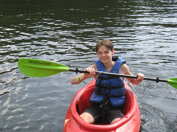 Camp Wannaklot - Boy in a Kayak