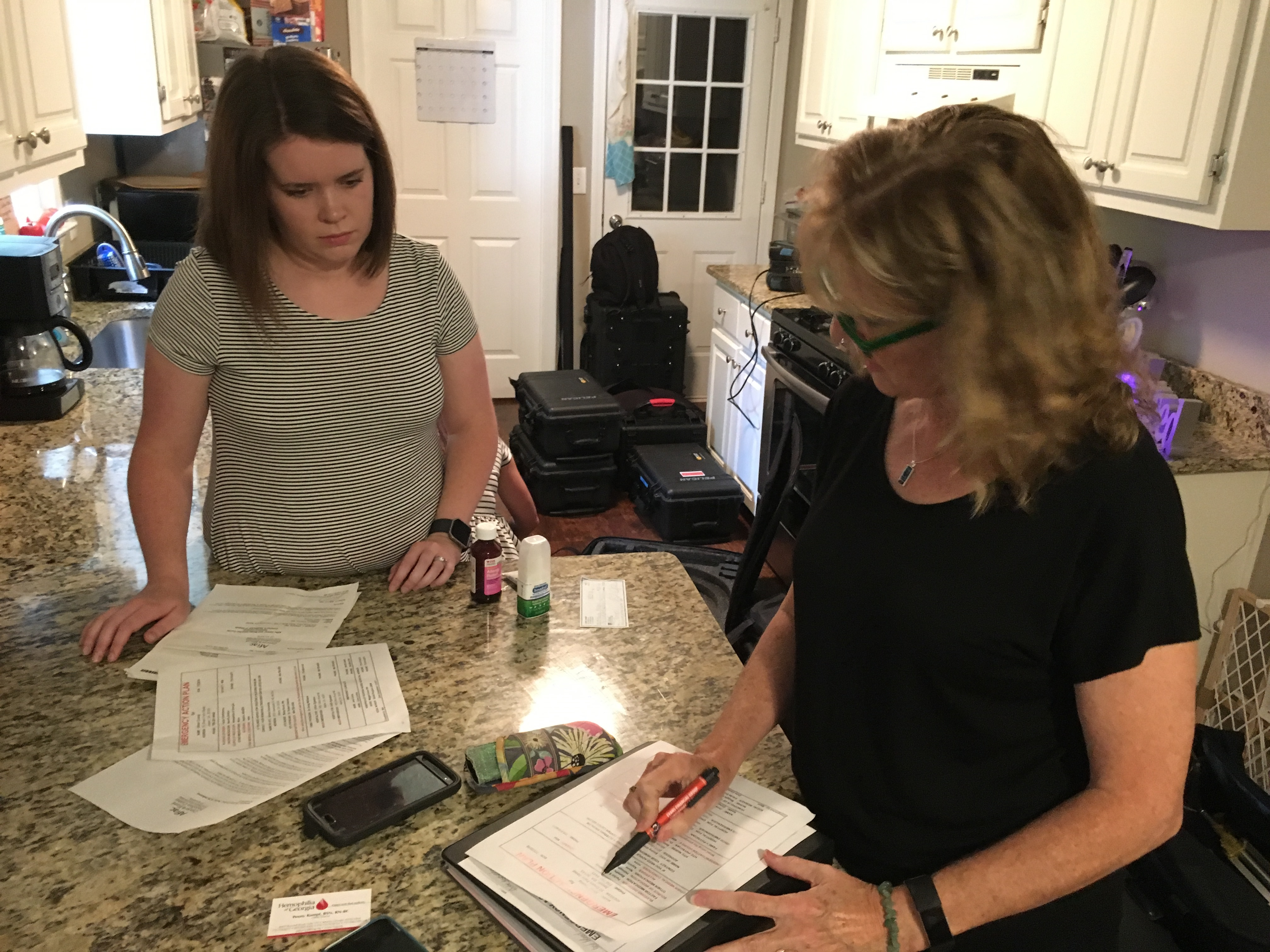 Outreach Nurse Discusses Emergency Action Plan in Client Home