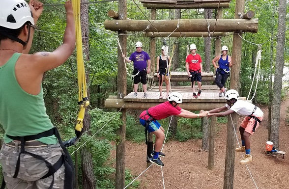 Teen boys on ropes course at Camp Wannaklot