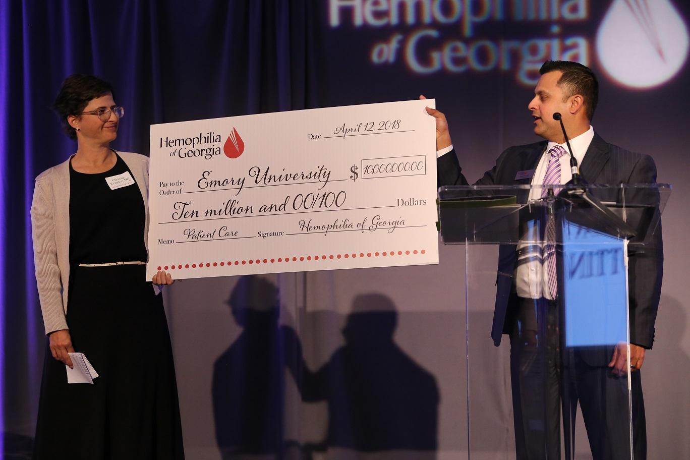 Tom Singh presents check to Christine Kempton
