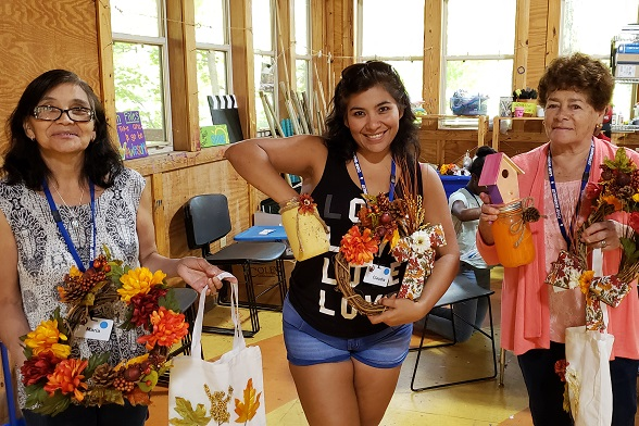 2018 Fall Family Camp Three Women Make Fall Wreaths in the Craft Room