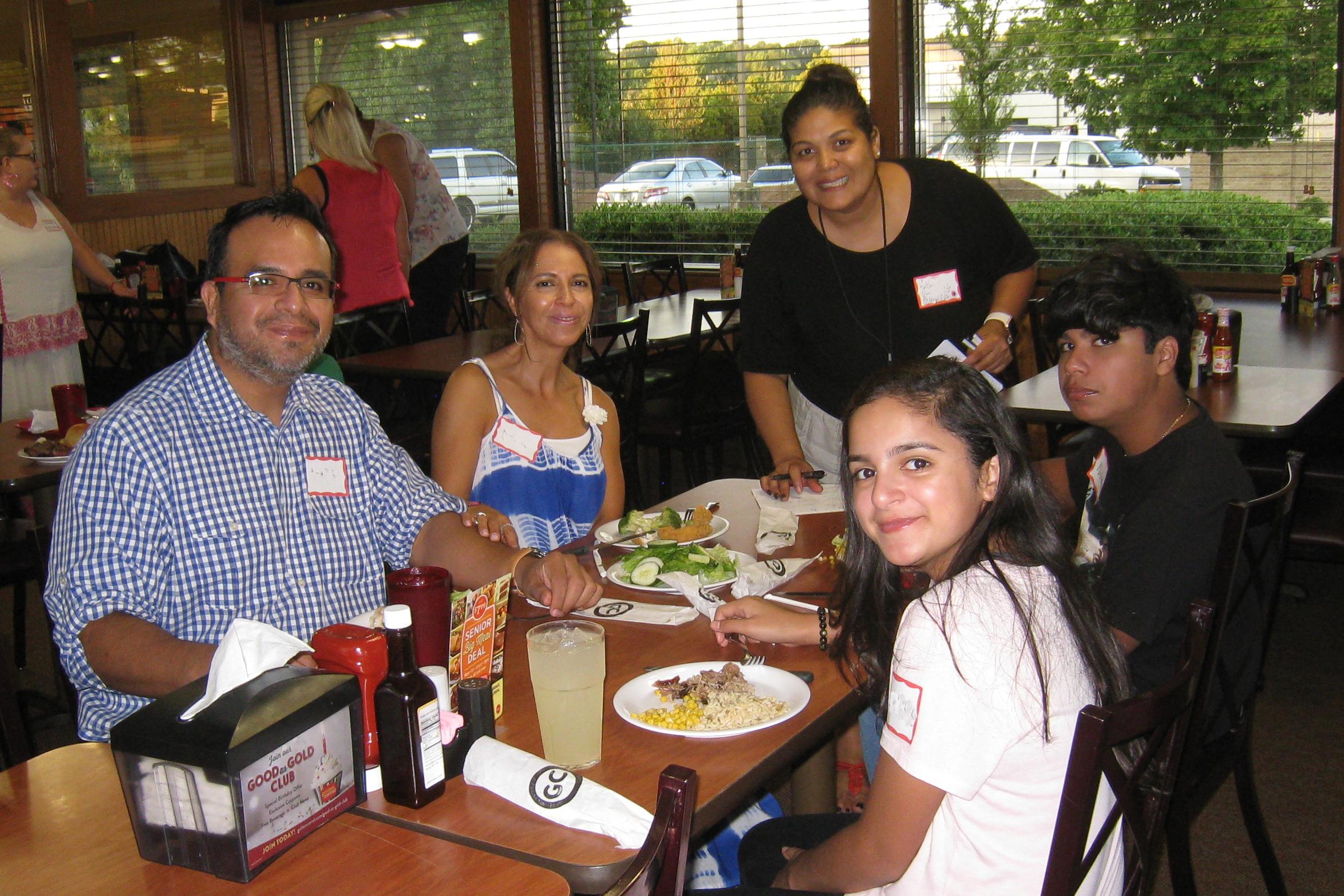 Spanish Speaking Family at Community Dinner in Lawrenceville