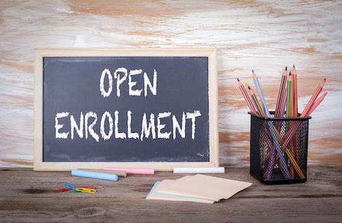 open enrollment spelled out on a chaulkboard