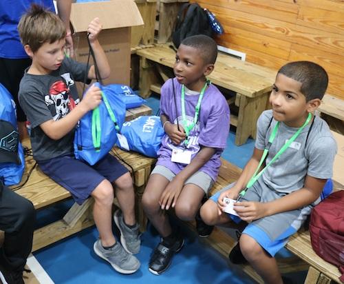 3 boys crafting at camp wannaklot
