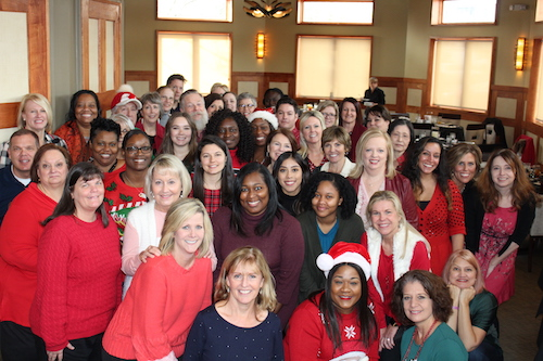 HoG Staff Holiday Photo, staff is wearing red sweaters