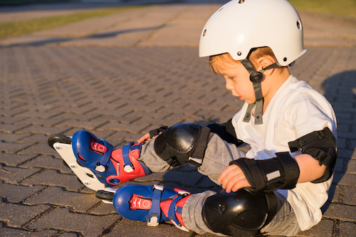 toddler in a helmet and roller blades