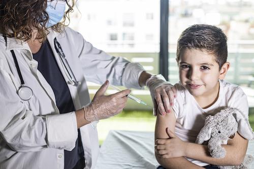 little boy receiving a shot