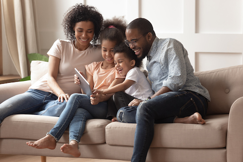African American Family looking at a tablet