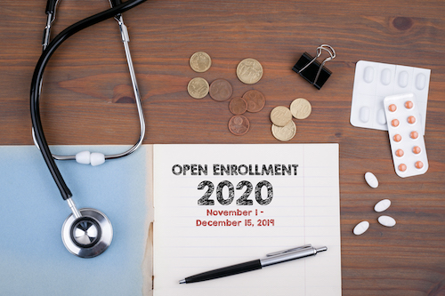 Open Enrollment 2020 papers on desk